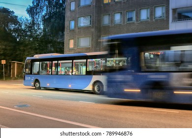 HELSINKI, FINLAND - AUGUST 22, 2017: Bus for town service; urban bus at night time. Municipal transport. Dynamic photo