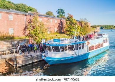 HELSINKI, FINLAND - AUGUST 24, 2016: Ferry arrived in Suomenlinna (Sveaborg) - inhabited sea fortress near Helsinki