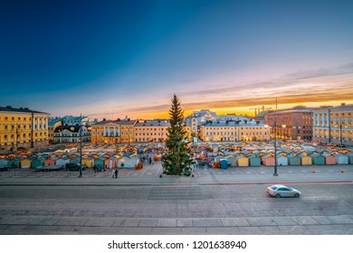Helsinki, Finland. Christmas Xmas Market With Christmas Tree On Senate Square In Sunset Sunrise Evening Illuminations.