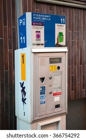HELSINKI, FINLAND - CIRCA, DEC, 2015: Automatic device to pay for parking is on the each street of city. Ticket box for fee paying
