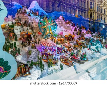 HELSINKI, FINLAND - Dec 14, 2018: New Year and Christmas Storefronts And Window Displays, captivating a story of winter with tiny homes and many puppets, each one of them making a different action.