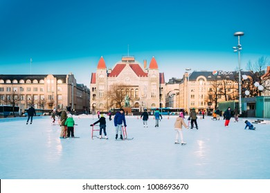 Helsinki, Finland - December 10, 2016: Children Skating On Rink On Railway Square On Background Of Finnish National Theatre In Winter Sunny Day.