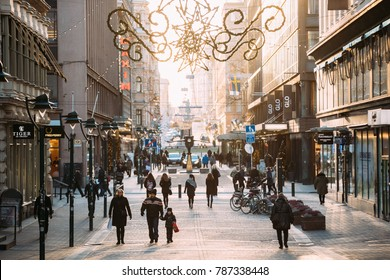 Helsinki, Finland - December 10, 2016: People Walking On Kluuvikatu Street In Winter Sunny Day. Street Decorated For Christmas And New Year Holidays