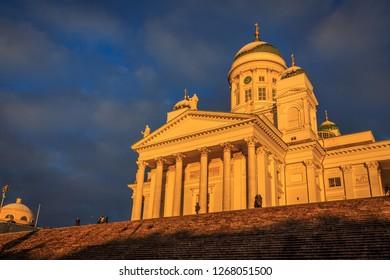 HELSINKI, FINLAND - DECEMBER 2ND, 2017: Sunrise reflecting off Helsinki Cathedral