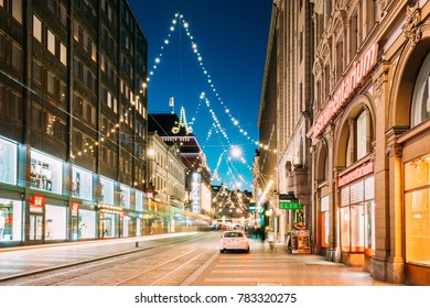 Helsinki, Finland - December 6, 2016: Night View Of Aleksanterinkatu Street With Railroad In Kluuvi District In Evening Christmas Xmas New Year Festive Illumination.