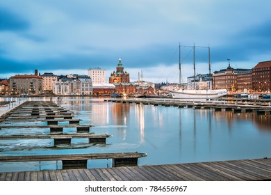 Helsinki, Finland - December 6, 2016: View Of Evening City And Uspenski Cathedral From Pier.