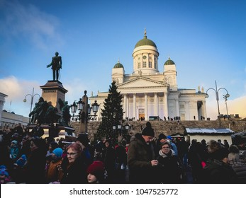 HELSINKI, FINLAND - DECEMBER 6, 2017: A crowd gathers in the Christmas market in Helsinki's senate square to celebrate Finland's 100th year of independence