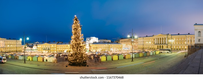 Helsinki, Finland. Evening Panorama Panoramic View Of Christmas Tree On Senate Square In Evening Night Christmas Xmas Festive Illuminations.