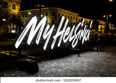 HELSINKI, FINLAND - February 10, 2017: The MyHelsinki sign at night in Pohjoisesplanadi, logo of the tourist information office and local guide of Helsinki, capital city of Finland