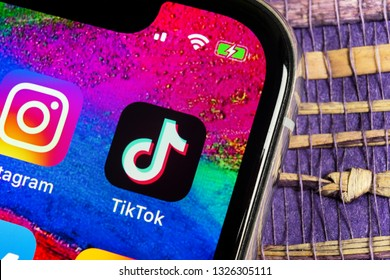 Helsinki, Finland,  February 17, 2019: Tik Tok application icon on Apple iPhone X screen close-up. Tik Tok icon. tik tok application. Tiktok Social media network. Social media icon