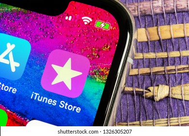 Helsinki, Finland, February 17, 2019: Apple iTunes store application icon on Apple iPhone X smartphone screen close-up. Mobile application icon of itunes store. Social network. AppStore. itunes store