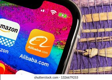 Helsinki, Finland, February 17, 2019: Alibaba application icon on Apple iPhone X smartphone screen close-up. Alibaba app icon. Alibaba.com is popular e-commerce application. Social media icon
