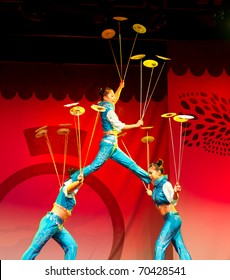 HELSINKI, FINLAND - FEBRUARY 2: Chinese New Year 2011 celebration - Chinese acrobats with spinning plates performing live on stage at Lasipalatsi Square on February 2, 2011 in Helsinki, Finland.