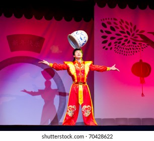 HELSINKI, FINLAND - FEBRUARY 2: Chinese New Year 2011 celebration - Chinese acrobat with a pot performing live on stage at Lasipalatsi Square on February 2, 2011 in Helsinki, Finland