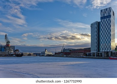 HELSINKI, FINLAND - February 24, 2017: Winter evening view of Lansisatama (West harbor) in Helsinki, Finland with newly built high-rise Clarion Hotel, Hietalahti Shipyards and passenger terminal.