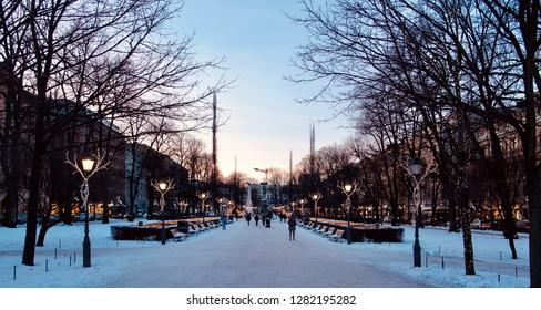 Helsinki, Finland. January 12 2019 - The Esplanadi Park with the statue of Johan Ludvig Runeberg and night illumination