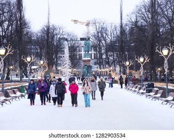 Helsinki, Finland. January 13 2019 - The Esplanadi Park with the statue of Johan Ludvig Runeberg and night illumination