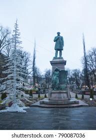 HELSINKI, FINLAND - January 3, 2018: View of the Runeberg Statue in Esplanade park in Helsinki