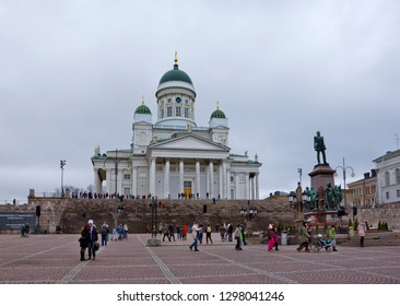 Helsinki, Finland - January 4, 2018: Senate Square with Alexander II Monument (by Walter Runeberg and Johannes Takanen, made in 1894), many people and Helsinki cathedral