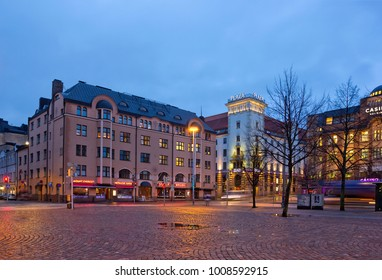 HELSINKI, FINLAND - JANUARY 5, 2018: Central Station Square with Plaza Hotel at night