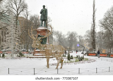 HELSINKI, FINLAND - JANUARY 9, 2016: Esplanadi park in snowy winter. It was originally opened in 1812. There is statue of Johan Ludwig Runeberg by his son Walter Runeberg in park