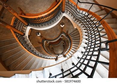 HELSINKI, FINLAND -JUL 17,2016: Aleksanterinkatu street, Pohjola Bank. Spiral staircase with wooden railings