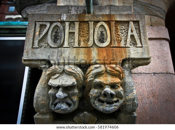 HELSINKI, FINLAND -JUL 17,2016: Aleksanterinkatu street, facade of Pohjola Bank wth faces of mythology characters