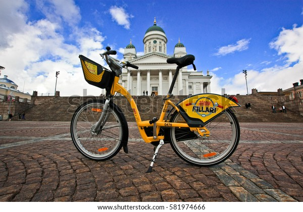 HELSINKI, FINLAND -JUL 19,2016: Yellow bicycle on background Helsinki cathedral