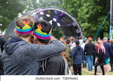 HELSINKI, FINLAND - JULY 01, 2017.LGBT ( Lesbian, Gay, Bisexual, Transgender) Pride event. Gay couple at a Pride parade concert in Kaivopuisto park outdoors.