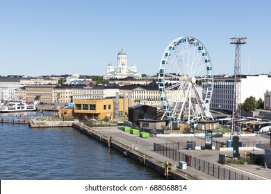 HELSINKI, FINLAND - JULY 07, 2017: Helsinki city panorama with ferris wheel and St. Nicholas cathedral in background on July 07, 2017