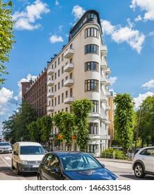 HELSINKI, FINLAND - JULY 18, 2019: Street view with flatiron building in Ullanlinna, southern Helsinki, Finland