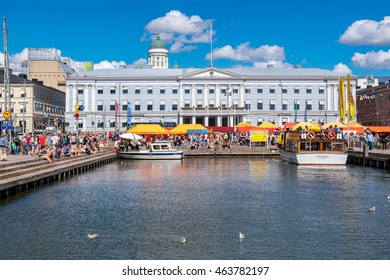 HELSINKI, FINLAND - JULY 19, 2016: Many people enjoy a summers day on a Market Square near Helsinki harbor