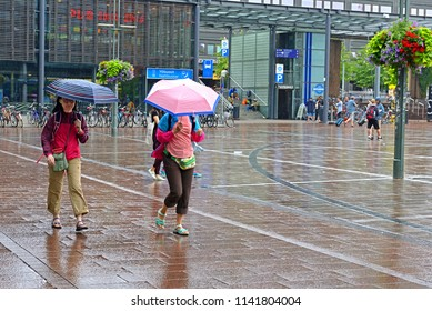 HELSINKI, FINLAND - JULY 20, 2018: Narinkka Square. Heavy rain. Women under umbrellas