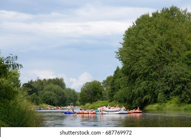 HELSINKI, FINLAND - JULY 30, 2016: Unidentified people rafting and tubing in Vantaanjoki river on rubber dinghies and other inflatable floating devices at Kaljakellunta (Beer Floating) festival.
