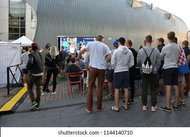 HELSINKI, FINLAND - JULY 7, 2018: 2018 FIFA World Cup. People watching Quarter-final Russia-Croatia in street cafe in Helsinki