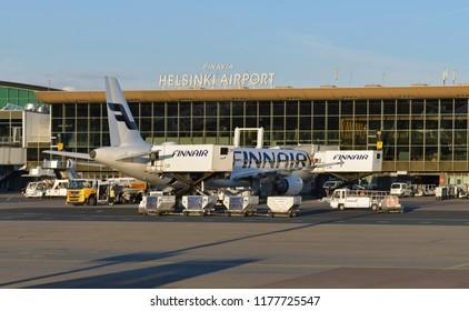HELSINKI, FINLAND - JULY 7, 2018: Helsinki International Airport. Terminal building and Finnair Airbus