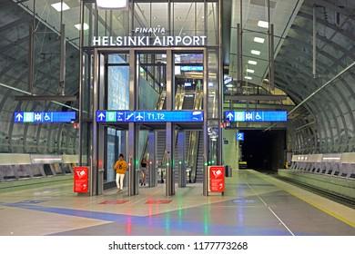 HELSINKI, FINLAND - JULY 7, 2018: Helsinki Airport Railway Station. Escalators