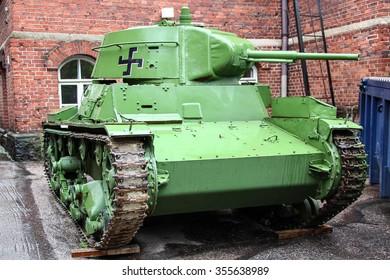 Helsinki, Finland - Jun 12 2014, Russian tank 30s T-26 with a Finnish swastika, a tank captured by Finnish army during winter Soviet-Finnish war, on Jun 12 2014 in War Museum, Helsinki, Finland