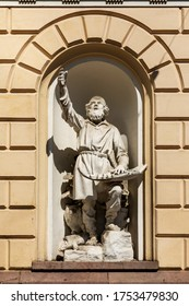 """Helsinki, Finland - jun 6th 2020: Väinämöinen is a demigod hero and central character in Finnish folklore """"Kalevala"""". His statue is in front of old Students House downtown Helsinki."""