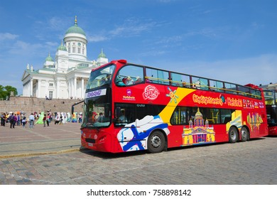 "HELSINKI, FINLAND - JUNE 11, 2017: Sightseeing bus of the ""Hop On Hop Off"" system on the Senate Square on a sunny June day"