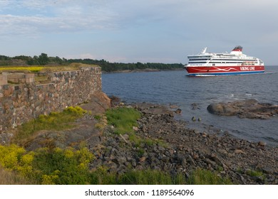 HELSINKI, FINLAND - JUNE 11, 2018: Cruiseferry Viking XPRS of Viking Line going to the port of Helsinki near Suomenlinna fortress. Suomenlinna is UNESCO World Heritage site since 1991