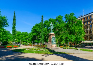 HELSINKI, FINLAND - JUNE 16, 2017: View of the Esplanade Park and the Runeberg Statue, with locals and visitors, in Helsinki, Finland