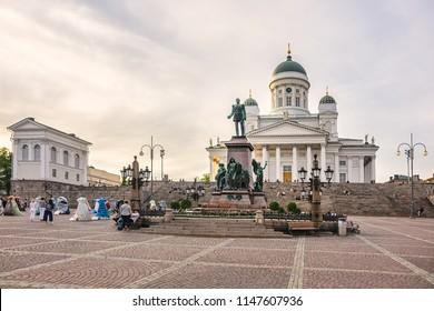 HELSINKI, FINLAND - JUNE 18, 2017: Helsinki Senate Square (Senaatintori, 18th century) and Helsinki Cathedral in the background. Senate Square - one of Helsinki main tourist attractions. Sunset.
