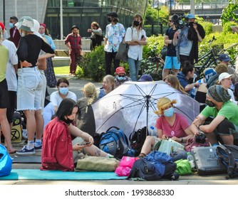 Helsinki, Finland - June 18, 2021: Extinction Rebellion Finland arrange a protest for the climate change.  Protesters cat off traffic on main Mannerheim Street living in tents nearby Parliament House.