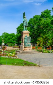 HELSINKI, FINLAND - JUNE 24, 2017: View of the Esplanade Park and the Runeberg Statue, with locals and visitors, in Helsinki, Finland