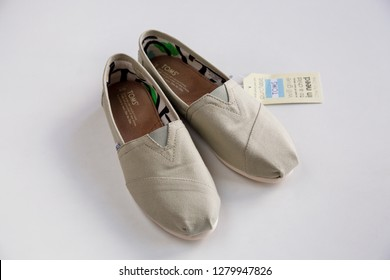 Helsinki, Finland - June 27 2015: Toms shoes. Classic canvas alpargatas women's espadrilles by TOMS, American footwear brand from California.