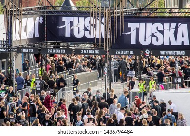 Helsinki, Finland - June 28, 2019 - People on the entrance gates of Tuska Open Air Metal Festival 2019 opening day