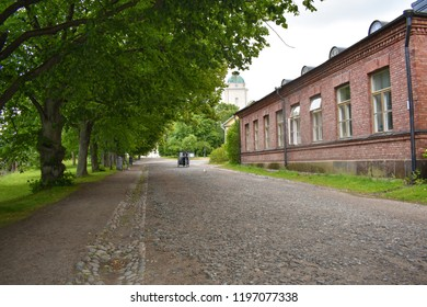 Helsinki, Finland - June 29 2018: One of the many buildings and streets inside the Suomenlinna Sea Fortress in Helsinki, Finland. Suomenlinna is a UNESCO World Heritage Site.