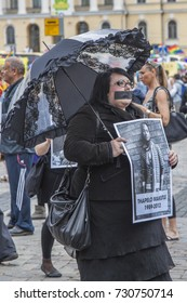 HELSINKI, FINLAND - JUNE 30, 2012: People at gay pride parade.  People paying a tribute to victims of homophobic violence in Chile, Iraq, Iran.