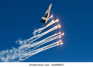 HELSINKI, FINLAND - JUNE 9, 2017: Finnish Air Force Hornet F/A-18  shooting out flares at the Kaivopuisto Air Show in Helsinki, Finland on 9 June 2017.
